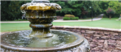 Image of a fountain at Tara Drummond Memorial Park on the Silver Comet Trail with the trail in the b